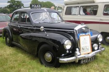 1280px-Wolseley_6_80_Police_car_per_the_British_movies_of_the_day.jpg